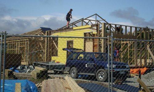 Man on a house frame